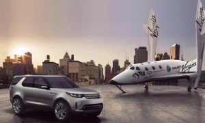 Discovery Vision Concept SUV alongside a scale model of the Virgin Galactic spacecraft
