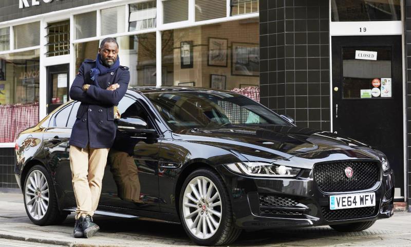 Idris Elba with a Jaguar XE