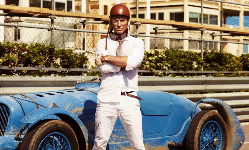 Jude Law behind the scenes on the set of The Gentleman's Wager II, a short film from Johnnie Walker Blue Label. Law races a Delahaye 135S classic racing car