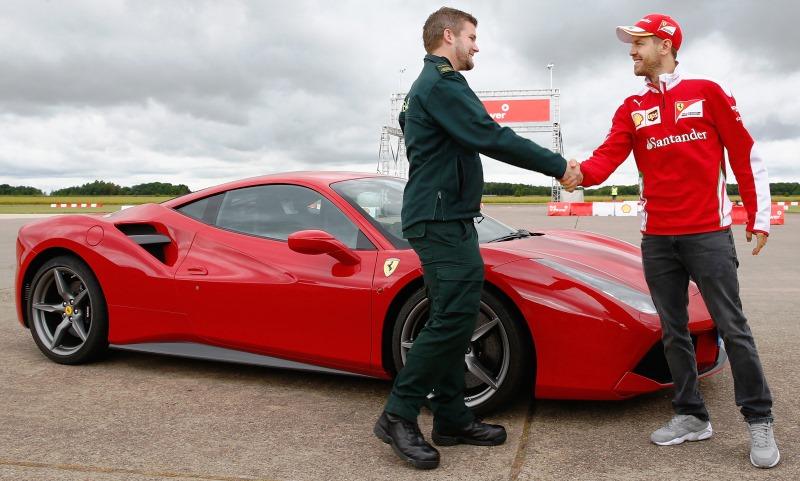 Paramedic Alex Knapton and Ferrari driver Sebastian Vettel