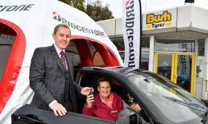 Mrs Jane Robinson our lucky prize winner of a brand new BMW 118 I pictured at Bush Tyres in Grimsby