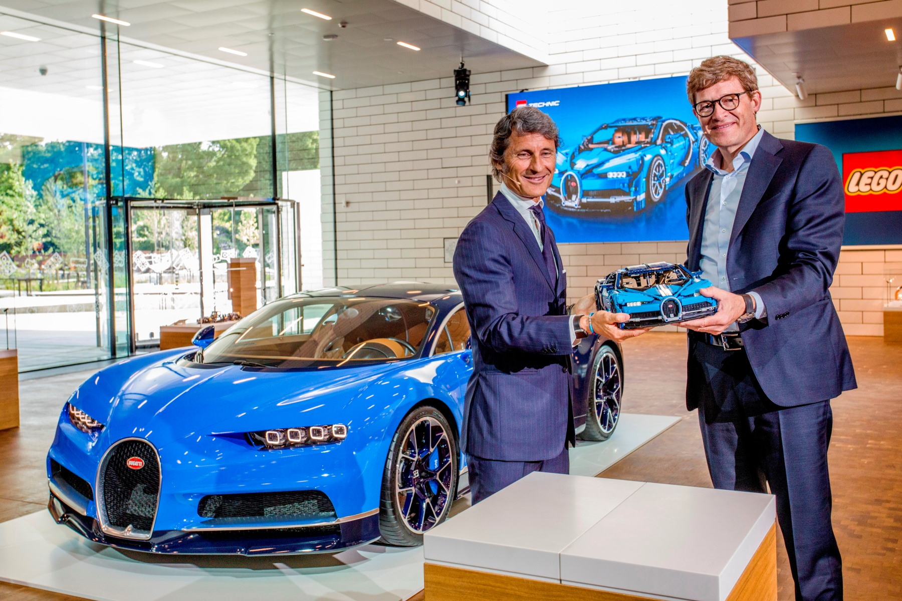 Niels B. Christiansen, CEO of the LEGO Group, (right) and Bugatti President Stephan Winkelmann